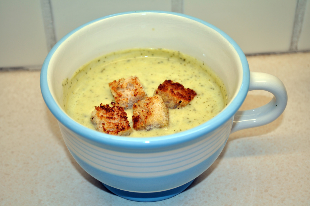 Courgette soup with croutons in a bowl