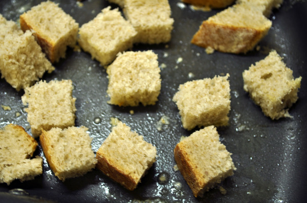 Sourdough croutons frying