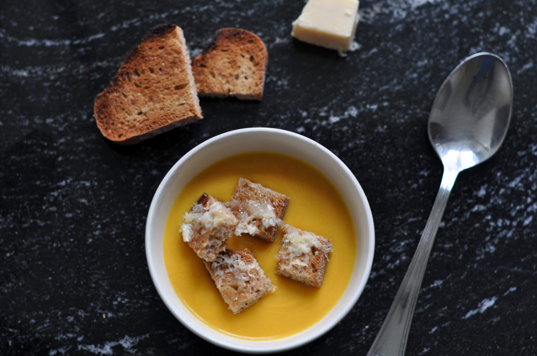Carrot soup with cheesy croutons