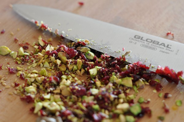 Chopping cranberries and pistachios