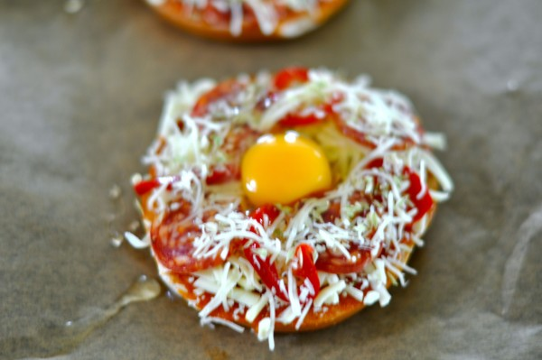 Pizza bagel with egg before oven