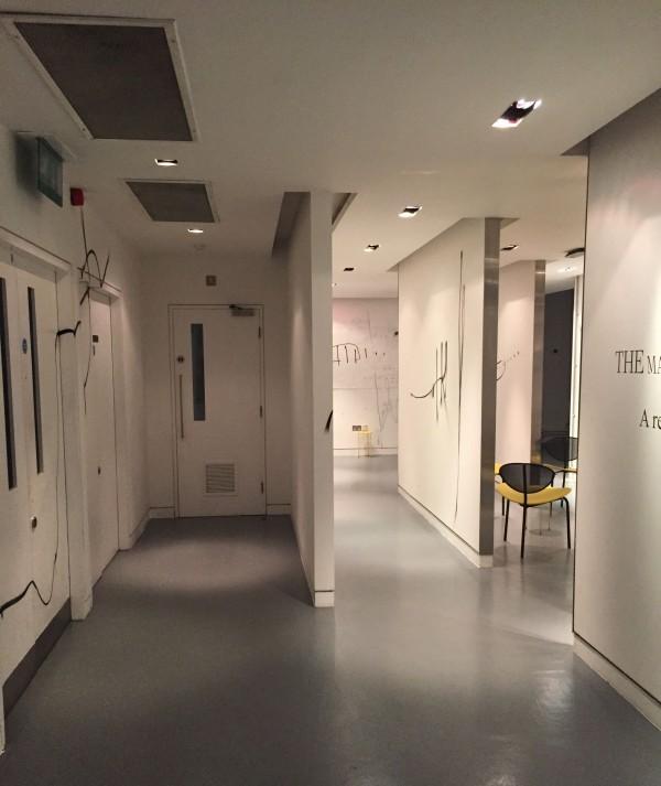 The Man Behind the Curtain Inside corridor