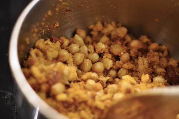 Adding chickpeas to migas