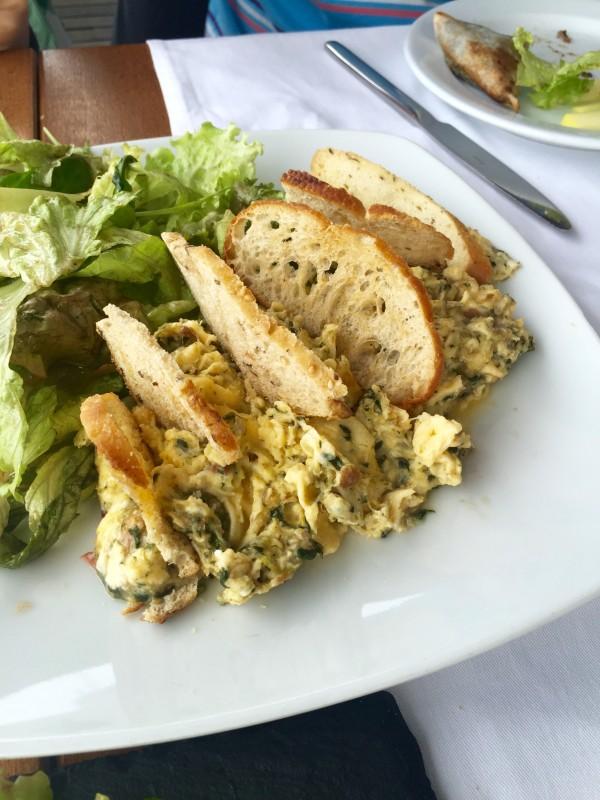 Game sausage and spinach scrambled eggs at Tavi