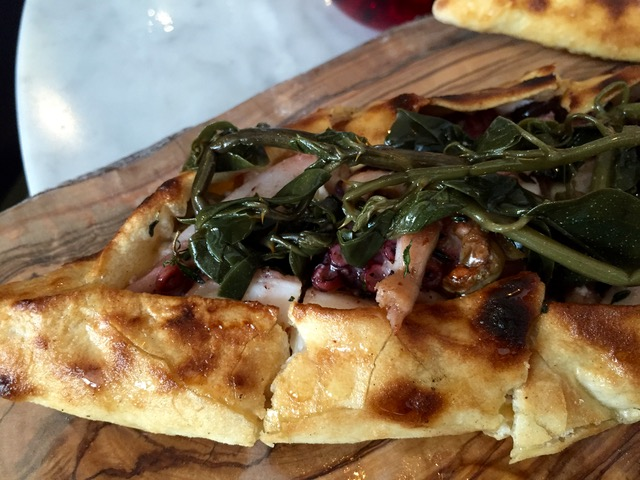 Octopus flatbread with ricotta, olives, honey, pickled caper shoots and thyme